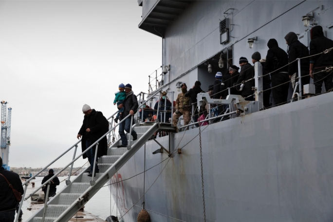 Syrian migrants disembarking from an Italian navy ship, before being transferred a reception centre in Siracusa, Sicily. Photo: Francesca Leonardi/Save the Children